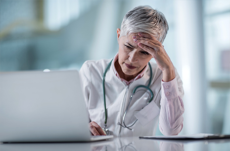 image-doctor stressed at computer